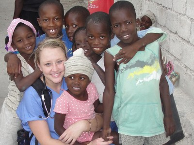 Kaci with Haitian Children