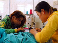 outreach_cgi_daughters_sewing